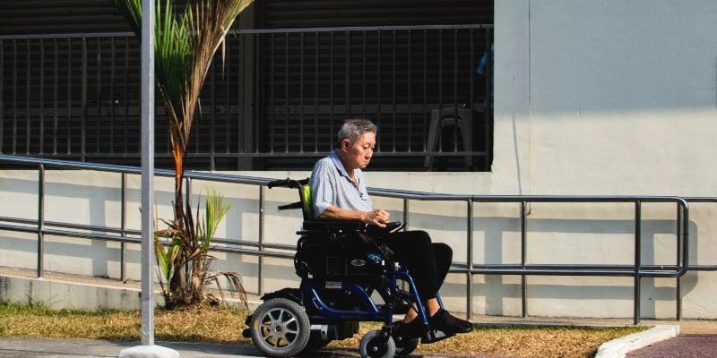 elderly using an electric wheelchair