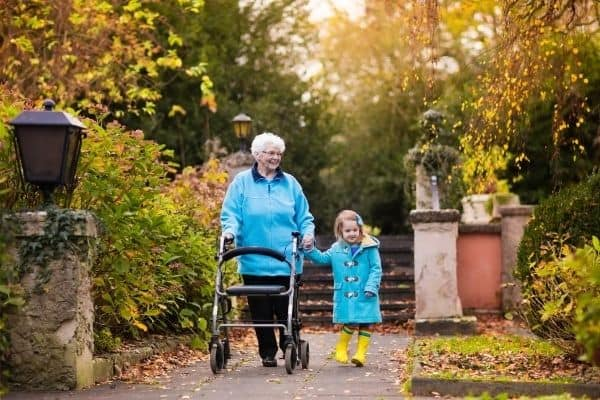 Child and elderly using rollator