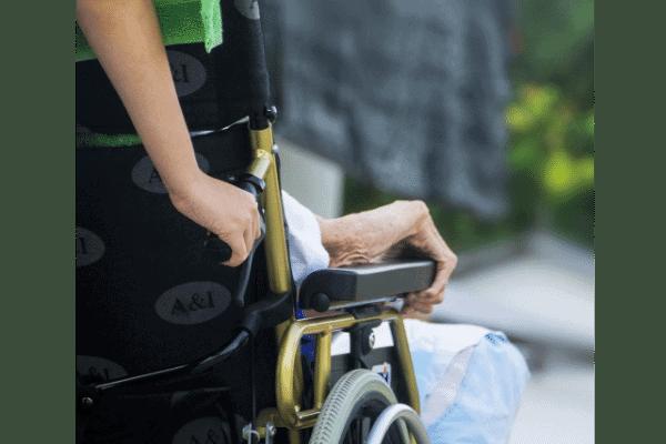 Elderly on a wheelchair with Headrest