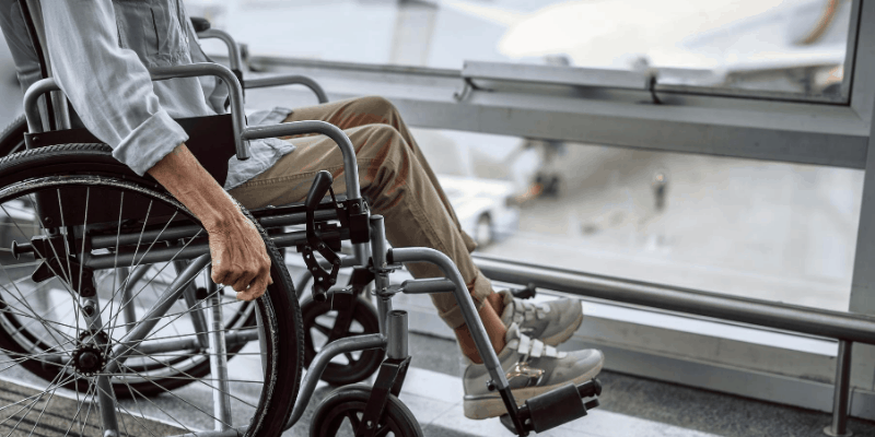 Man on wheelchair in the airport