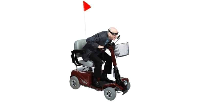 Happy elderly riding mobility scooter