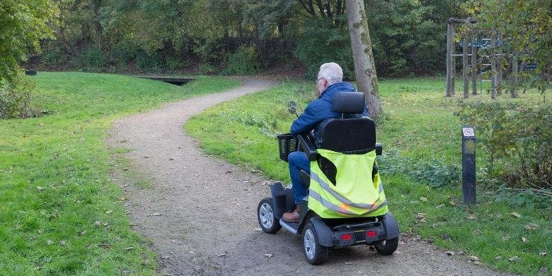 Elderly traveling on a mobility scooter