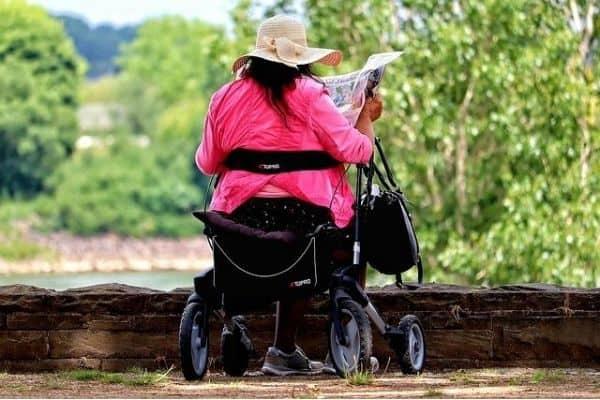 Woman sitting on a rollator