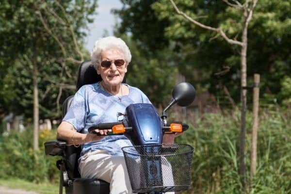 Elderly woman on a mobility scooter