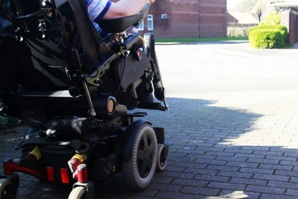 Person using electric wheelchair outside