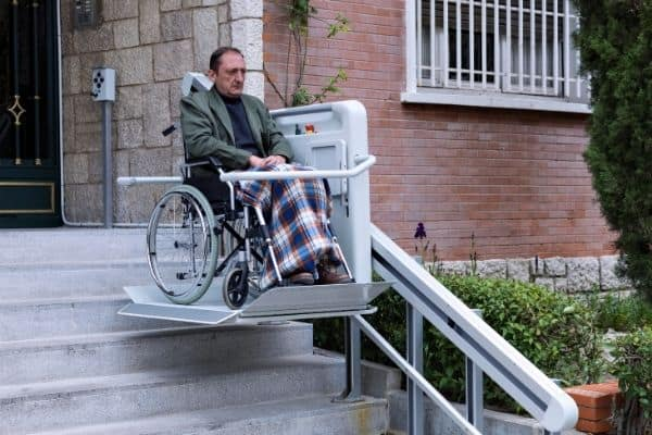 Elderly on high technology wheelchair ramp