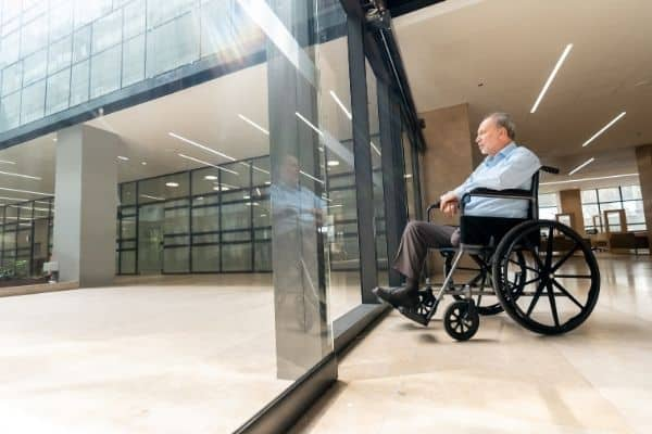 Person on a wheelchair looking outside