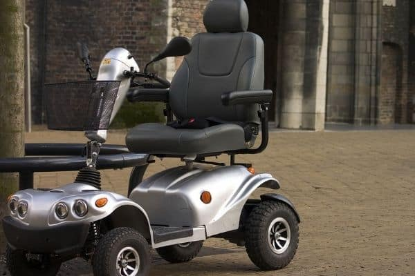 Gray and black mobility scooter parked outdoors