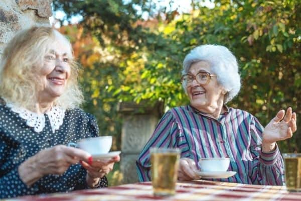 Elderly women talking while having a cup of tea