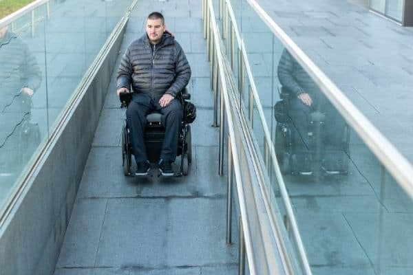 Person outside riding a power wheelchair