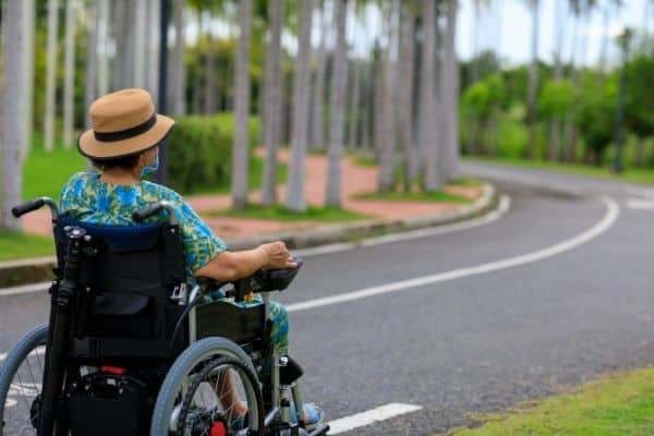 Woman on power wheelchair outdoors