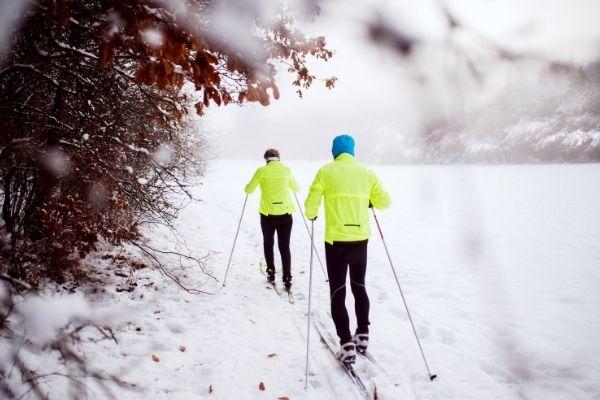 Elderly people cross country skiing
