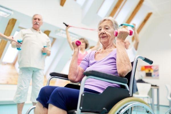 Senior doing lift exercise on wheelchair