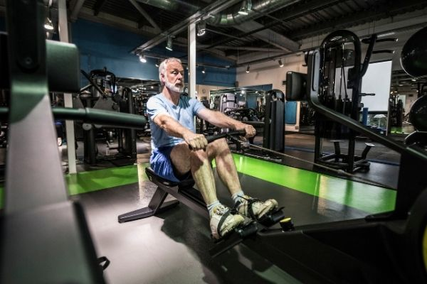 Elderly person using a rowing machine